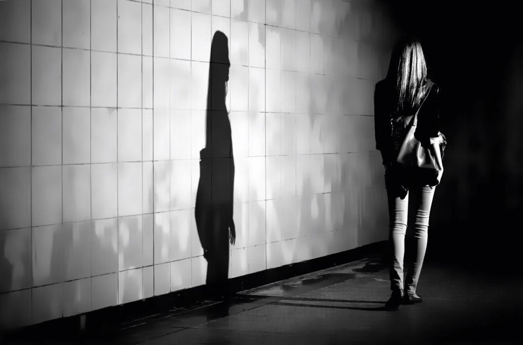 View-of-woman-walking-alone-at-night-1024x676